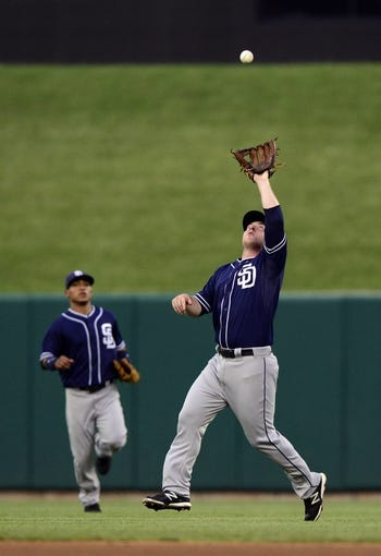 Jul 19, 2013; St. Louis, MO, USA; San Diego Padres second baseman Jedd Gyorko (9) catches a fly ball hit by St. Louis Cardinals first baseman Allen Craig (not pictured) during the third inning at Busch Stadium. Mandatory Credit: Jeff Curry-USA TODAY Sports
