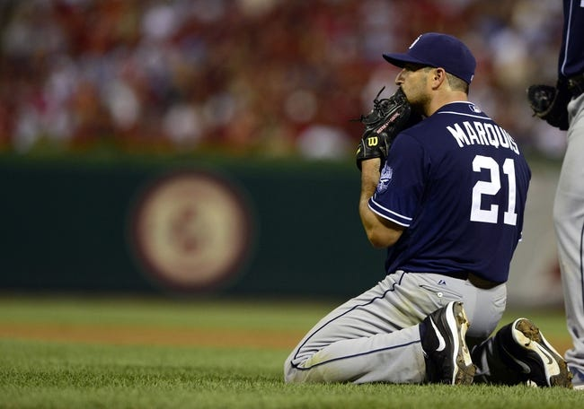 Jul 19, 2013; St. Louis, MO, USA; San Diego Padres starting pitcher Jason Marquis (21) looks on after unsuccessfully sliding for a ball hit by St. Louis Cardinals shortstop Pete Kozma (not pictured) during the sixth inning at Busch Stadium. Mandatory Credit: Jeff Curry-USA TODAY Sports