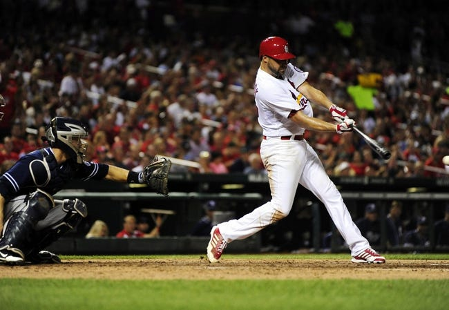 Jul 19, 2013; St. Louis, MO, USA; St. Louis Cardinals starting pitcher Jake Westbrook (35) hits a one run single off of San Diego Padres starting pitcher Jason Marquis (not pictured) during the sixth inning at Busch Stadium. Mandatory Credit: Jeff Curry-USA TODAY Sports