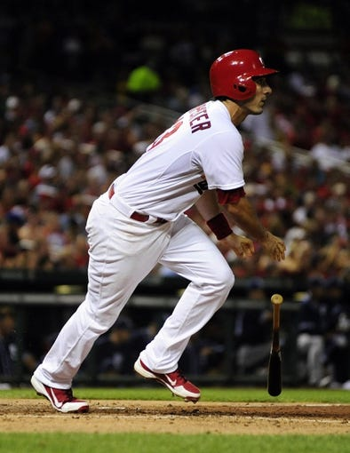 Jul 19, 2013; St. Louis, MO, USA; St. Louis Cardinals second baseman Matt Carpenter (13) hits a two run single off of San Diego Padres relief pitcher Colt Hynes (not pictured) during the sixth inning at Busch Stadium. Mandatory Credit: Jeff Curry-USA TODAY Sports