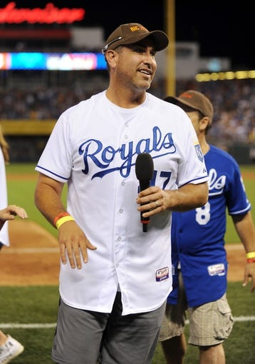 """Jul 19, 2013; Kansas City, MO, USA; Rob Riggle walks off the field after singing """"Take Me Out to the Ball Game"""" during the seventh inning of the game between the Kansas City Royals and Detroit Tigers at Kauffman Stadium. Mandatory Credit: Denny Medley-USA TODAY Sports"""