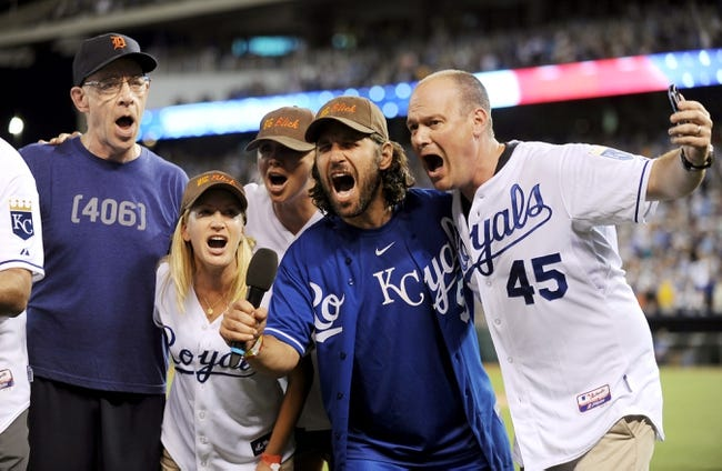 """Jul 19, 2013; Kansas City, MO, USA; J.K. Simmons, Angela Kinsey, Sarah Chalke, Paul Rudd, and Rich Eisen (left to right) sing """"Take Me Out to the Ball Game"""" during the seventh inning of the game between the Kansas City Royals and Detroit Tigers at Kauffman Stadium. Mandatory Credit: Denny Medley-USA TODAY Sports"""
