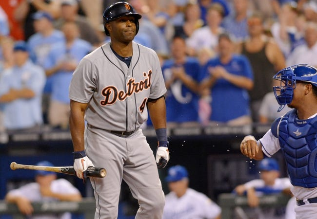 Jul 19, 2013; Kansas City, MO, USA; Detroit Tigers right fielder Torii Hunter (48) reacts to a called strike in the ninth inning of the game against the Kansas City Royals at Kauffman Stadium. The Royals won 1-0. Mandatory Credit: Denny Medley-USA TODAY Sports
