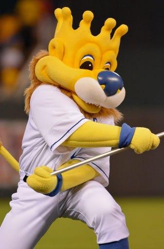 Jul 19, 2013; Kansas City, MO, USA; Kansas City Royals mascot Sluggerrr celebrates after the game against the Detroit Tigers at Kauffman Stadium. The Royals won 1-0. Mandatory Credit: Denny Medley-USA TODAY Sports