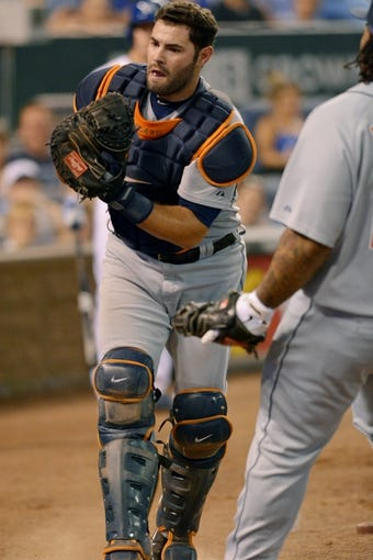 Jul 19, 2013; Kansas City, MO, USA; Detroit Tigers catcher Alex Avila (13) drops an attempt on a foul ball in the fifth inning of the game against the Kansas City Royals at Kauffman Stadium. The Royals won 1-0. Mandatory Credit: Denny Medley-USA TODAY Sports