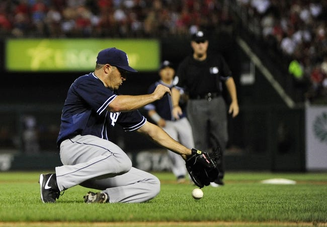Jul 19, 2013; St. Louis, MO, USA; San Diego Padres starting pitcher Jason Marquis (21) slides unsuccessfully for  a ball hit by St. Louis Cardinals shortstop Pete Kozma (not pictured) during the sixth inning at Busch Stadium. St. Louis defeated San Diego 9-6. Mandatory Credit: Jeff Curry-USA TODAY Sports