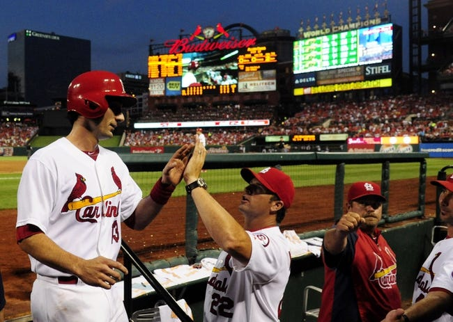 Jul 19, 2013; St. Louis, MO, USA; St. Louis Cardinals second baseman Matt Carpenter (13) is congratulated by manager Mike Matheny (22) after he scored during the fifth inning against the San Diego Padres at Busch Stadium. St. Louis defeated San Diego 9-6. Mandatory Credit: Jeff Curry-USA TODAY Sports