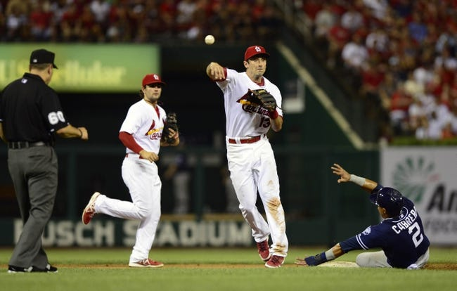 Jul 19, 2013; St. Louis, MO, USA; St. Louis Cardinals second baseman Matt Carpenter (13) completes the double play as San Diego Padres shortstop Everth Cabrera (2) slides during the seventh inning at Busch Stadium. St. Louis defeated San Diego 9-6. Mandatory Credit: Jeff Curry-USA TODAY Sports