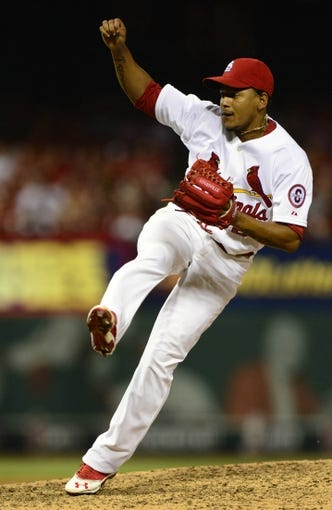 Jul 19, 2013; St. Louis, MO, USA; St. Louis Cardinals relief pitcher Carlos Martinez (62) throws to a San Diego Padres batter during the ninth inning at Busch Stadium. St. Louis defeated San Diego 9-6. Mandatory Credit: Jeff Curry-USA TODAY Sports