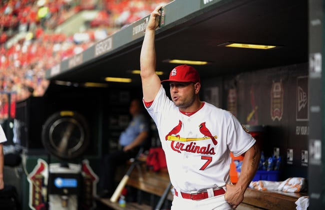 Jul 19, 2013; St. Louis, MO, USA; St. Louis Cardinals left fielder Matt Holliday (7) looks on from the dugout as his team plays the San Diego Padres at Busch Stadium. St. Louis defeated San Diego 9-6. Mandatory Credit: Jeff Curry-USA TODAY Sports