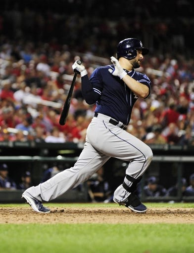 Jul 19, 2013; St. Louis, MO, USA; San Diego Padres first baseman Yonder Alonso (23) hits a one run single off of St. Louis Cardinals relief pitcher Carlos Martinez (not pictured) during the ninth inning at Busch Stadium. St. Louis defeated San Diego 9-6. Mandatory Credit: Jeff Curry-USA TODAY Sports