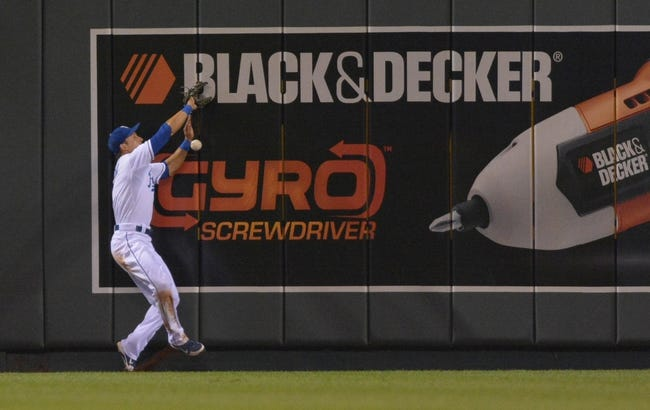 Jul 20, 2013; Kansas City, MO, USA; Kansas City Royals right fielder David Lough (7) cannot make the catch at the wall in right field in the ninth inning of the game against the Detroit Tigers at Kauffman Stadium. The Royals won 6-5. Mandatory Credit: Denny Medley-USA TODAY Sports