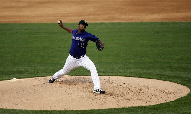 Jul 20, 2013; Denver, CO, USA; Colorado Rockies pitcher Juan Nicasio (12) delivers a pitch during the third inning against the Chicago Cubs at Coors Field. Mandatory Credit: Chris Humphreys-USA TODAY Sports