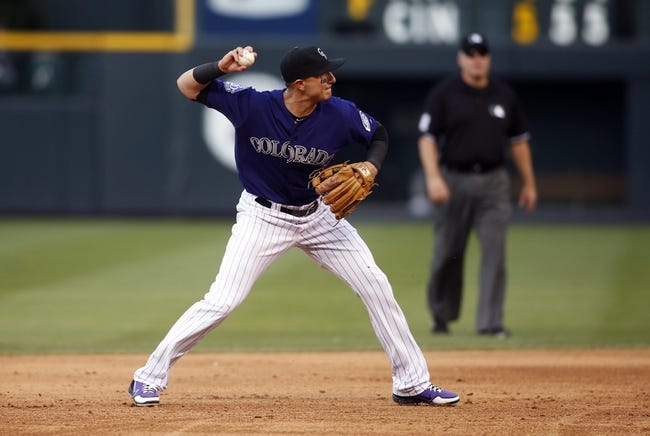 Jul 20, 2013; Denver, CO, USA; Colorado Rockies shortstop Troy Tulowitzki (2) fields a ground ball during the third inning against the Chicago Cubs at Coors Field. Mandatory Credit: Chris Humphreys-USA TODAY Sports