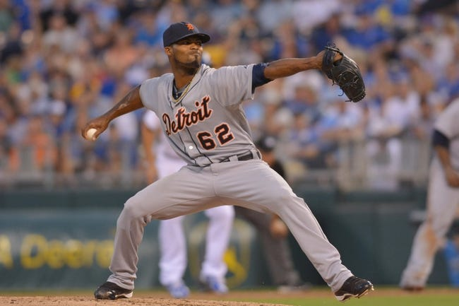 Jul 20, 2013; Kansas City, MO, USA; Detroit Tigers relief pitcher Al Alburquerque (62) delivers a pitch in the sixth inning of the game against the Kansas City Royals at Kauffman Stadium. The Royals won 6-5. Mandatory Credit: Denny Medley-USA TODAY Sports