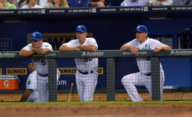 Jul 20, 2013; Kansas City, MO, USA; Kansas City Royals hitting coach George Brett (5), pitching coach Dave Eiland (58), and manager Ned Yost (3) watch play from the dugout in the sixth inning of the game against the Detroit Tigers at Kauffman Stadium. The Royals won 6-5. Mandatory Credit: Denny Medley-USA TODAY Sports