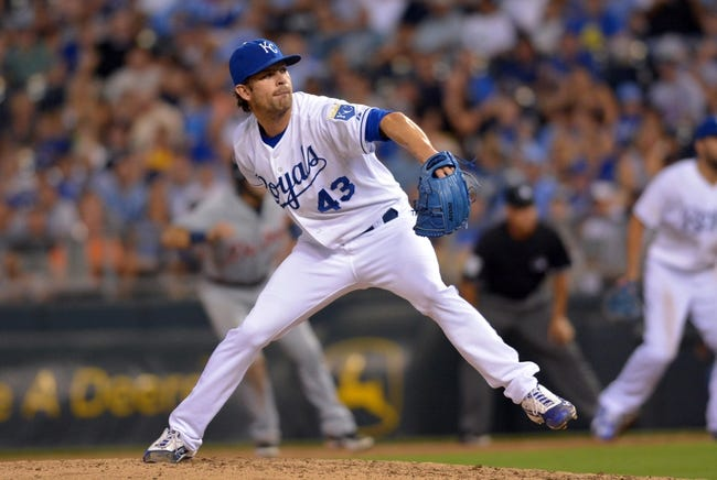 Jul 20, 2013; Kansas City, MO, USA; Kansas City Royals relief pitcher Aaron Crow (43) delivers a pitch in the eighth inning of the game against the Detroit Tigers at Kauffman Stadium. The Royals won 6-5. Mandatory Credit: Denny Medley-USA TODAY Sports