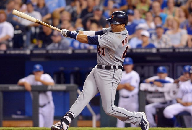 Jul 20, 2013; Kansas City, MO, USA; Detroit Tigers designated hitter Victor Martinez (41) connects for a double in the ninth inning of the game against the Kansas City Royals at Kauffman Stadium. The Royals won 6-5. Mandatory Credit: Denny Medley-USA TODAY Sports