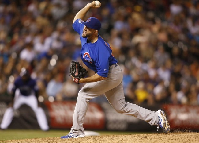 Jul 20, 2013; Denver, CO, USA; Chicago Cubs pitcher Blake Parker (50) delivers a pitch during the eighth inning against the Colorado Rockies at Coors Field. Mandatory Credit: Chris Humphreys-USA TODAY Sports