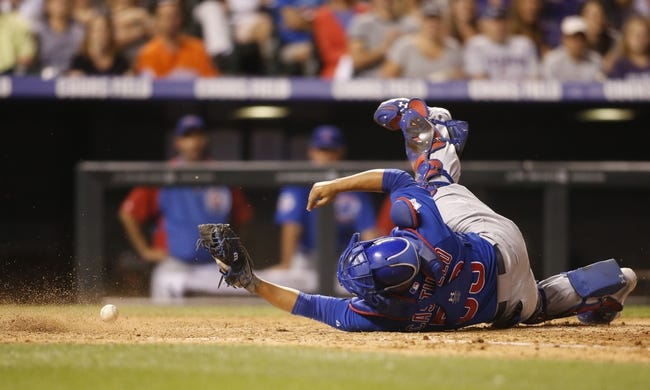 Jul 20, 2013; Denver, CO, USA; Chicago Cubs catcher Welington Castillo (53) can't hold onto the ball as he attempts to tag out Colorado Rockies center fielder Dexter Fowler (not pictured) during the eighth inning at Coors Field.  The Rockies won 9-3.  Mandatory Credit: Chris Humphreys-USA TODAY Sports