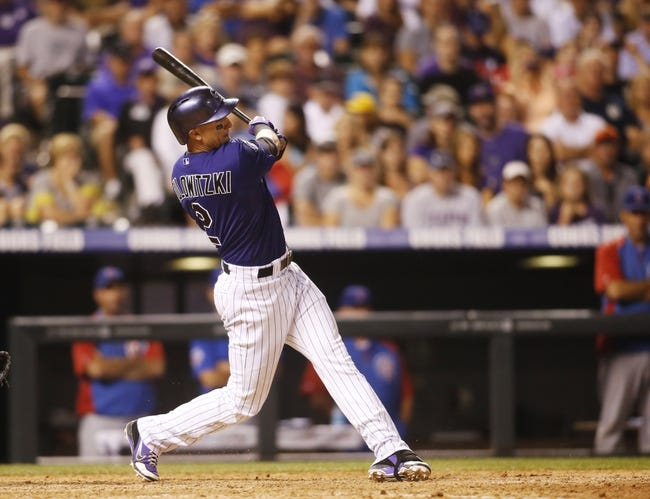 Jul 20, 2013; Denver, CO, USA; Colorado Rockies shortstop Troy Tulowitzki (2) hits an RBI double during the eighth inning against the Chicago Cubs at Coors Field.  The Rockies won 9-3.  Mandatory Credit: Chris Humphreys-USA TODAY Sports