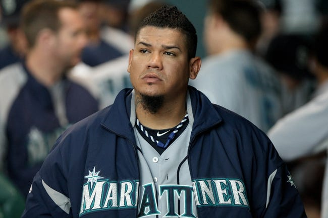 Jul 21, 2013; Houston, TX, USA; Seattle Mariners starting pitcher Felix Hernandez (34) walks in the dugout during a game against the Houston Astros at Minute Maid Park. Mandatory Credit: Troy Taormina-USA TODAY Sports