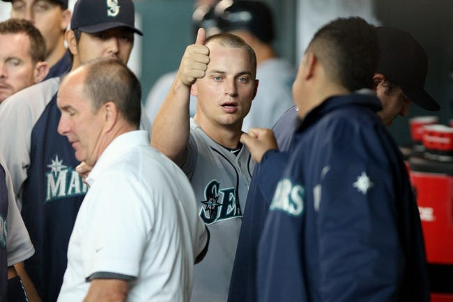 Jul 21, 2013; Houston, TX, USA; Seattle Mariners third baseman Kyle Seager (15) is congratulated after scoring a run during the second inning against the Houston Astros at Minute Maid Park. Mandatory Credit: Troy Taormina-USA TODAY Sports