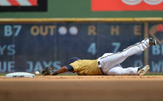Jul 21, 2013; Milwaukee, WI, USA; Milwaukee Brewers shortstop Jean Segura commits an error on a ball hit by Miami Marlins right fielder Giancarlo Stanton (not pictured) in the 7th inning at Miller Park. Mandatory Credit: Benny Sieu-USA TODAY Sports