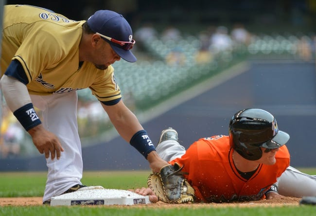 Jul 21, 2013; Milwaukee, WI, USA;  Miami Marlins second baseman Derek Dietrich (right) gets back to first base before the tag by Milwaukee Brewers first baseman Juan Francisco (left) on a pickoff attempt in the 8th inning lat Miller Park. Mandatory Credit: Benny Sieu-USA TODAY Sports