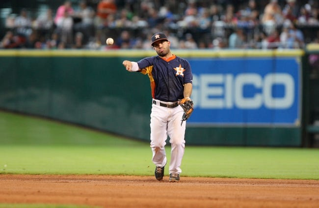 Jul 21, 2013; Houston, TX, USA; Houston Astros second baseman Jose Altuve (27) throws to first base during the sixth inning against the Seattle Mariners at Minute Maid Park. Mandatory Credit: Troy Taormina-USA TODAY Sports