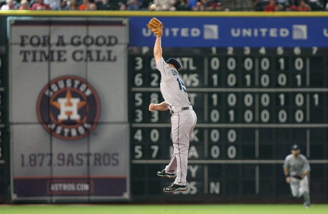 Jul 21, 2013; Houston, TX, USA; Seattle Mariners third baseman Kyle Seager (15) leaps for a line drive during the sixth inning against the Houston Astros at Minute Maid Park. Mandatory Credit: Troy Taormina-USA TODAY Sports