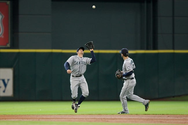 Jul 21, 2013; Houston, TX, USA; Seattle Mariners shortstop Brad Miller (5) catches a fly ball during the fourth inning against the Houston Astros at Minute Maid Park. Mandatory Credit: Troy Taormina-USA TODAY Sports