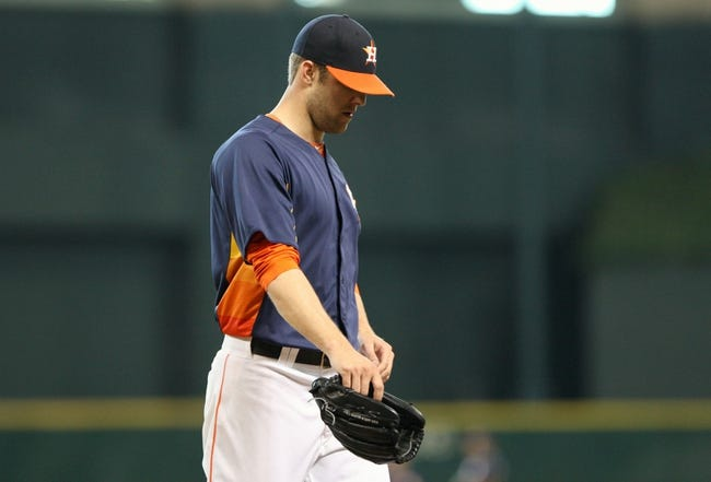 Jul 21, 2013; Houston, TX, USA; Houston Astros starting pitcher Jordan Lyles (18) walks off the mound during the fifth inning against the Seattle Mariners at Minute Maid Park. Mandatory Credit: Troy Taormina-USA TODAY Sports