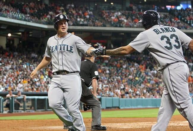Jul 21, 2013; Houston, TX, USA; Seattle Mariners third baseman Kyle Seager (15) is congratulated by Henry Blanco (33) after scoring a run during the fifth inning against the Houston Astros at Minute Maid Park. Mandatory Credit: Troy Taormina-USA TODAY Sports