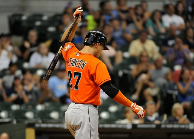Jul 21, 2013; Milwaukee, WI, USA;  Miami Marlins right fielder Giancarlo Stanton reacts after striking out in the 11th inning against the Milwaukee Brewers at Miller Park. Mandatory Credit: Benny Sieu-USA TODAY Sports