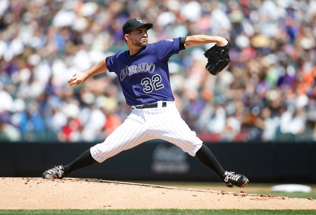 Jul 21, 2013; Denver, CO, USA; Colorado Rockies pitcher Tyler Chatwood (32) delivers a pitch during the first inning against the Chicago Cubs at Coors Field. Mandatory Credit: Chris Humphreys-USA TODAY Sports
