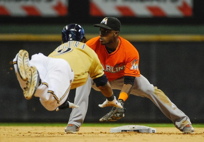 Jul 21, 2013; Milwaukee, WI, USA;  Milwaukee Brewers shortstop Jean Segura (left) steals 2nd base as Miami Marlins shortstop Adeiny Hechavarria (right) waits for the ball in the 12th inning at Miller Park. Mandatory Credit: Benny Sieu-USA TODAY Sports