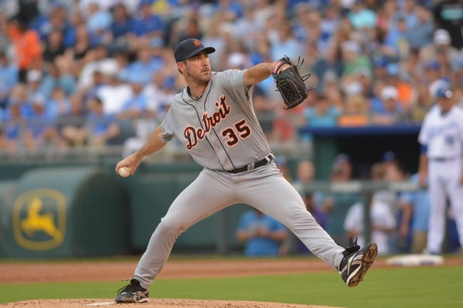 Jul 20, 2013; Kansas City, MO, USA; Detroit Tigers starting pitcher Justin Verlander (35) delivers a pitch early in the game against the Kansas City Royals at Kauffman Stadium. The Royals won 6-5. Mandatory Credit: Denny Medley-USA TODAY Sports