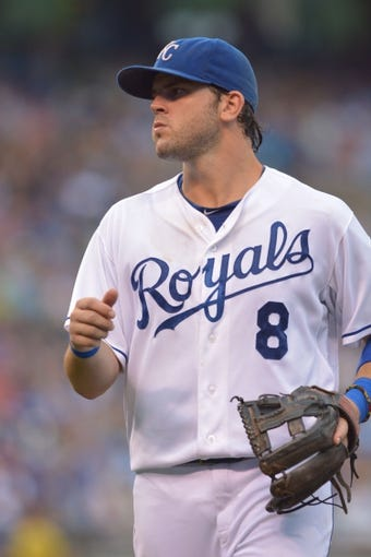 Jul 20, 2013; Kansas City, MO, USA; Kansas City Royals third baseman Mike Moustakas (8) takes the field in between innings in the game against the Detroit Tigers at Kauffman Stadium. The Royals won 6-5. Mandatory Credit: Denny Medley-USA TODAY Sports
