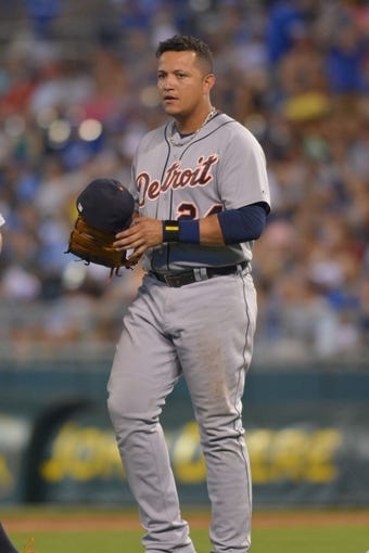 Jul 20, 2013; Kansas City, MO, USA; Detroit Tigers third baseman Miguel Cabrera (24) walks onto the field in between innings in the game against the Kansas City Royals at Kauffman Stadium. The Royals won 6-5. Mandatory Credit: Denny Medley-USA TODAY Sports