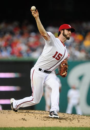 Jul 22, 2013; Washington, DC, USA; Washington Nationals starting pitcher Dan Haren (15) throws during the second inning against the Pittsburgh Pirates at Nationals Park. Mandatory Credit: Brad Mills-USA TODAY Sports