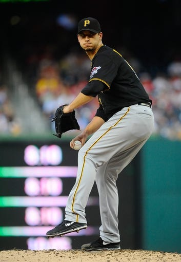 Jul 22, 2013; Washington, DC, USA; Pittsburgh Pirates starting pitcher Charlie Morton (50) throws during the second inning against the Washington Nationals at Nationals Park. Mandatory Credit: Brad Mills-USA TODAY Sports
