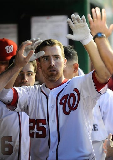 Jul 22, 2013; Washington, DC, USA; Washington Nationals first baseman Adam LaRoche (25) is congratulated by teammates after hitting a solo homer during the fifth inning against the Pittsburgh Pirates at Nationals Park. Mandatory Credit: Brad Mills-USA TODAY Sports