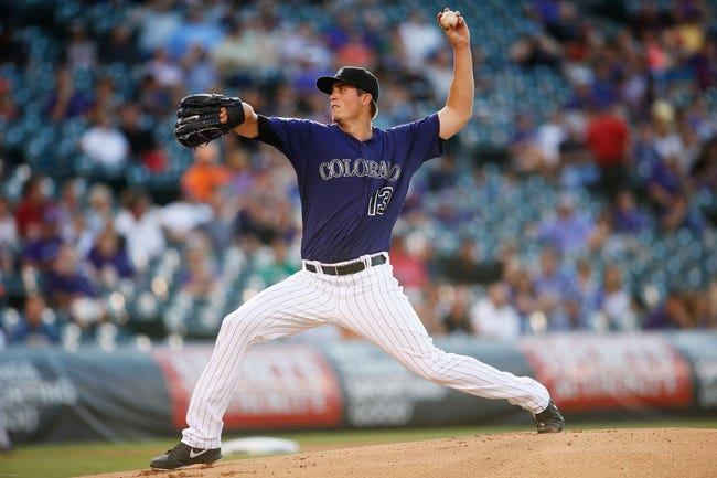 Jul 22, 2013; Denver, CO, USA; Colorado Rockies pitcher Drew Pomeranz (13) delivers a pitch during the first inning against the Miami Marlins at Coors Field. Mandatory Credit: Chris Humphreys-USA TODAY Sports