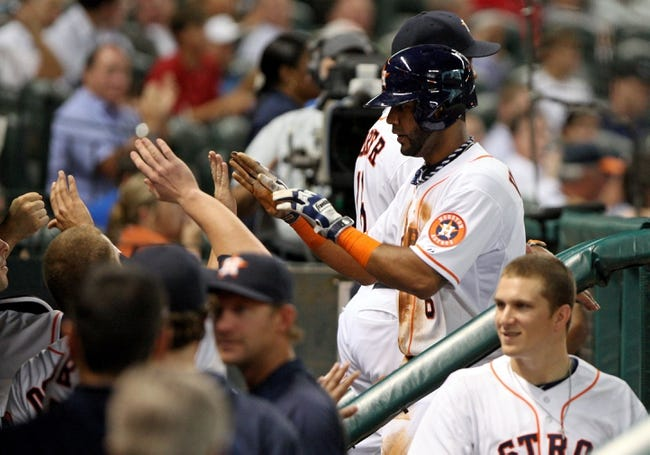 Jul 22, 2013; Houston, TX, USA; Houston Astros shortstop Jonathan Villar (6) is congratulated after scoring a run during the third inning against the Oakland Athletics at Minute Maid Park. Mandatory Credit: Troy Taormina-USA TODAY Sports