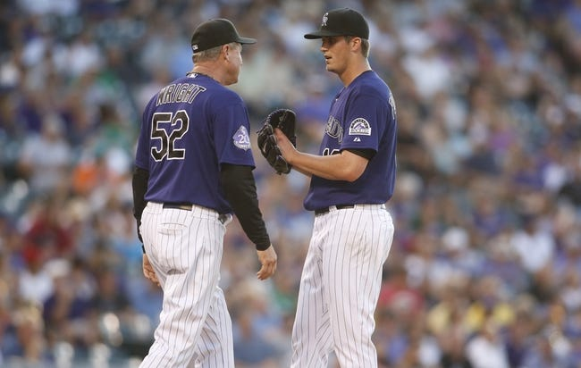 Jul 22, 2013; Denver, CO, USA; Colorado Rockies pitcher Drew Pomeranz (13) talks with pitching coach Jim Wright (52) during the third inning at Coors Field.Mandatory Credit: Chris Humphreys-USA TODAY Sports
