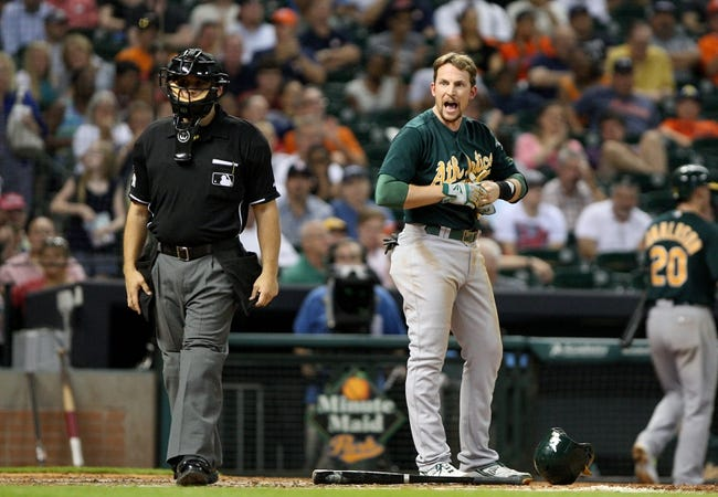 Jul 22, 2013; Houston, TX, USA; Oakland Athletics shortstop Jed Lowrie (8) has words with umpire Mark Wegner after striking out during the fifth inning against the Houston Astros at Minute Maid Park. Mandatory Credit: Troy Taormina-USA TODAY Sports