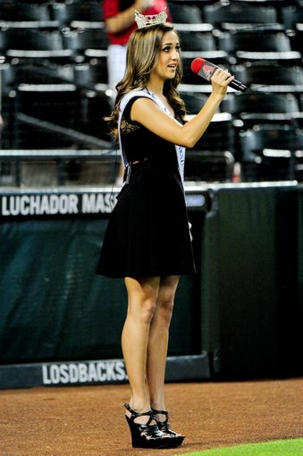 Jul 22, 2013; Phoenix, AZ, USA;  Jennifer Smestad miss arizona 2013  sings the national anthem prior to the game between the Arizona Diamondbacks and the Chicago Cubs at Chase Field. Mandatory Credit: Matt Kartozian-USA TODAY Sports