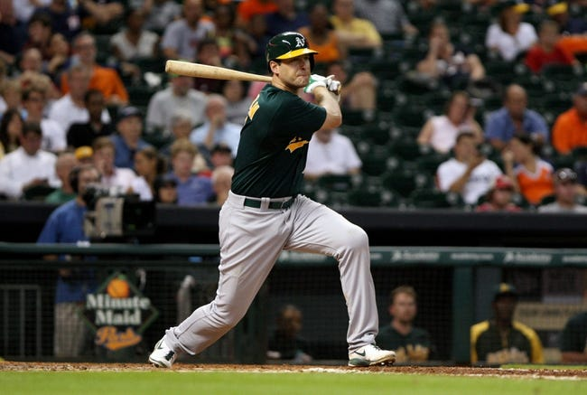 Jul 22, 2013; Houston, TX, USA; Oakland Athletics first baseman Nate Freiman (7) doubles during the sixth inning against the Houston Astros at Minute Maid Park. Mandatory Credit: Troy Taormina-USA TODAY Sports