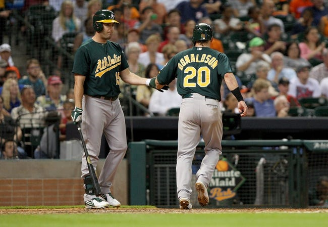 Jul 22, 2013; Houston, TX, USA; Oakland Athletics third baseman Josh Donaldson (20) is congratulated by Seth Smith (15) after scoring a run during the sixth inning against the Houston Astros at Minute Maid Park. Mandatory Credit: Troy Taormina-USA TODAY Sports